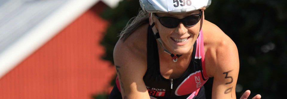 Krista Schultz racing a triathlon on the bike
