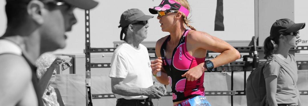 Krista Schultz running to triathlon finish line