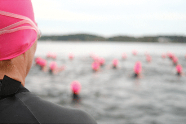 triathlete before the start of open water swim