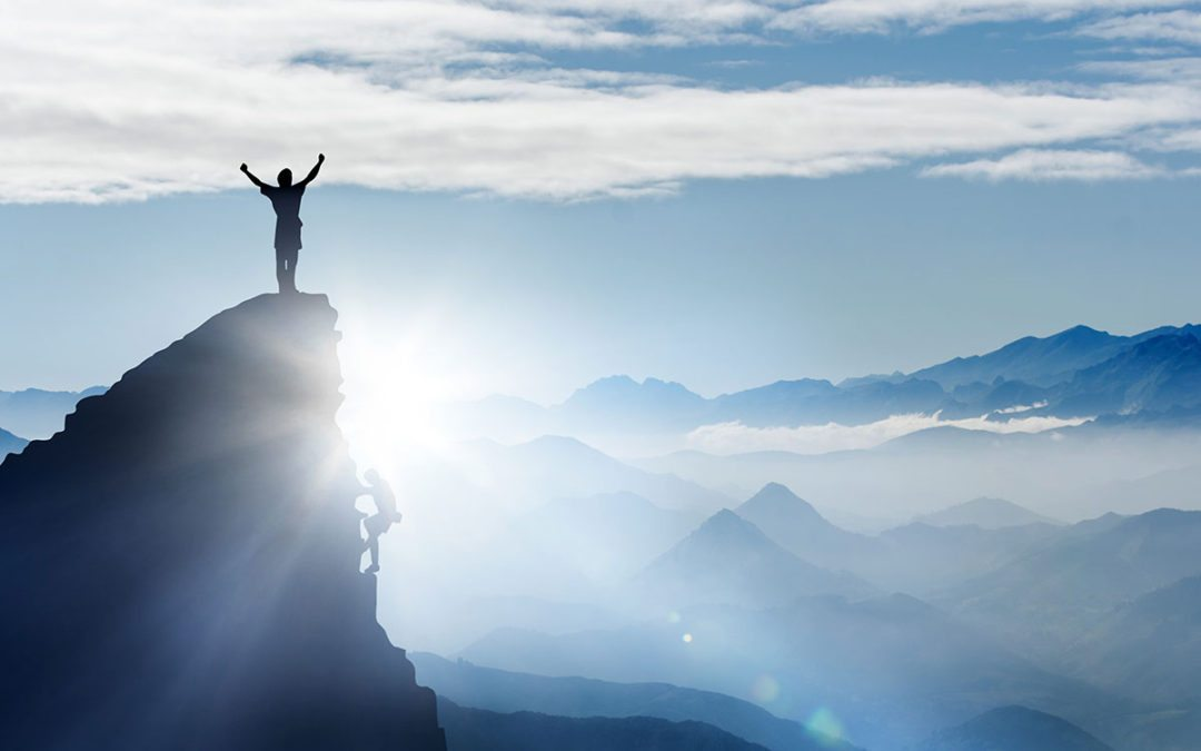 climbing to top of mountain